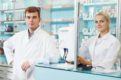 Pharmaceutical workers in drugstore Royalty Free Stock Images