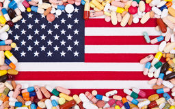 Pharmaceuticals on US flag. Various pharmaceuticals on flag of the USA stock photo
