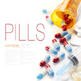 Pharmaceutics. Pills spilling out of pill bottle and Syringe isolated on white (with sample text Royalty Free Stock Photography