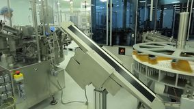 Pharmaceutics. Pharmaceutical worker operates tablet blister packaging machine. manufacture of syringes. syringe. Pharmaceutical industry. Line machine stock video footage