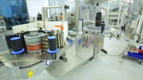 Pharmaceutics. Pharmaceutical worker operates tablet blister packaging machine. manufacture of syringes. syringe Stock Photo