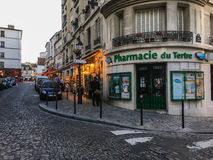 Pharmacie du Tertre at a street corner of Montmartre, Paris, France, on a summer evening. Stock Image