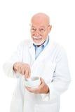 Pharmacien avec le mortier et le pilon photos stock