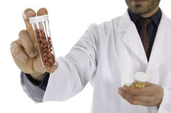 Pharmacist. Doctor or pharmacist with a pill and vitamin prescription Stock Image