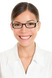 Pharmacist. Woman portrait. Closeup of young asian wearing glasses and lab coat isolated on white background royalty free stock photography