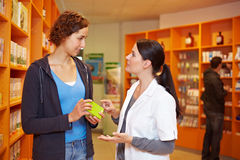 Pharmacist advising woman Royalty Free Stock Photography
