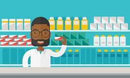 Pharmacist. An african-american pharmacist at the counter in a pharmacy opposite the shelves with medicines vector flat design illustration. Horizontal layout Royalty Free Stock Image