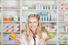 Pharmacist With Apple And Orange Royalty Free Stock Images