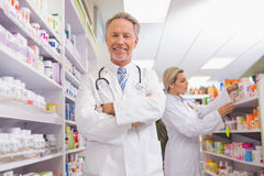 pharmacist with arms crossed and trainee behind stock photos - Pharmacist Trainee