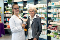 Pharmacist assisting an elderly lady Royalty Free Stock Photography