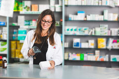 Pharmacist. Beautiful Pharmacist at Work in a Drugstore royalty free stock photos