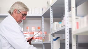 Pharmacist behind a hospital counter Stock Photo