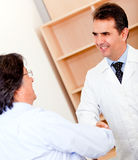 Pharmacist and business man handshaking Royalty Free Stock Photography