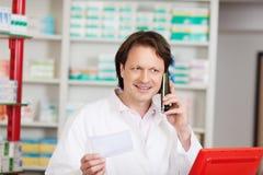 Pharmacist on call in a pharmacy Stock Photos