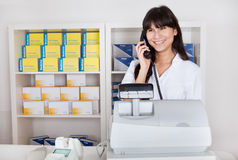 Pharmacist calling on the phone Royalty Free Stock Photo