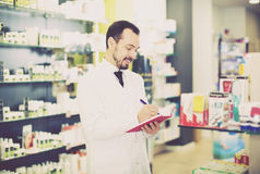 Pharmacist checking drugs in pharmacy Royalty Free Stock Photo