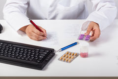 Pharmacist checking prescription Royalty Free Stock Photography