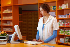 Pharmacist at checkout booth Stock Photo