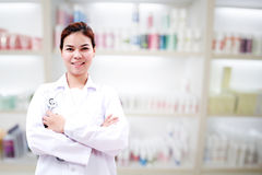Pharmacist chemist and medical doctor woman asia with stethoscop. E and clipboard checking medicine cabinet and pharmacy drugstore Royalty Free Stock Photo