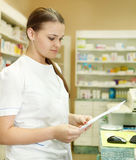 Pharmacist chemist woman with prescription Stock Image