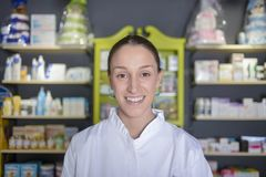 Environmental Portrait of a medical personnel, or doctor in pharmacy royalty free stock photo