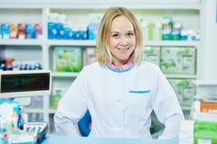 Pharmacist chemist woman working in pharmacy drugstore Royalty Free Stock Photos
