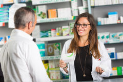 Pharmacist and Client. In a Drugstore Stock Photos