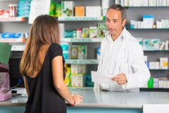 Pharmacist and Client. In a Drugstore Royalty Free Stock Photo