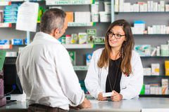 Pharmacist and Client. In a Drugstore Stock Photography