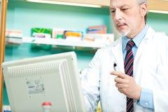 Pharmacist at cmoputer Stock Image
