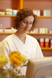 Pharmacist at the computer Stock Images