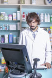 Pharmacist and computer Stock Image