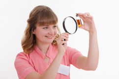 Pharmacist considers the liquid through a magnifying glass Royalty Free Stock Photos