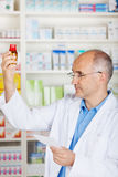 Pharmacist controlling medicine Stock Photos