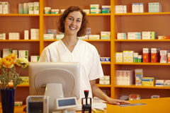 Pharmacist at counter Stock Image