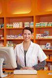 Pharmacist at counter in drugstore Royalty Free Stock Image