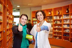 Pharmacist and customer holding Royalty Free Stock Image