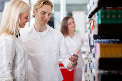 Pharmacist And Customers At Pharmacy Royalty Free Stock Image
