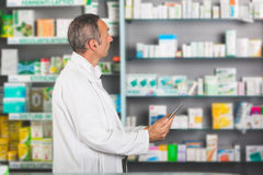 Pharmacist with Digital Tablet Royalty Free Stock Image