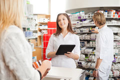 Pharmacist with Digital Tablet Royalty Free Stock Photography