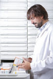 The pharmacist and the drawers Stock Photo