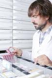 Pharmacist at the drawers Stock Photos