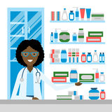 Pharmacist in drug store. Royalty Free Stock Photography