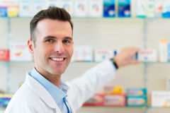 Pharmacist in drugstore. Searching the right medicine royalty free stock photography