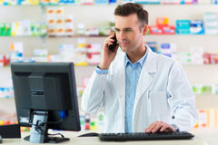 Pharmacist in drugstore Stock Photography