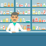 Pharmacist at the drugstore. Stock Photos