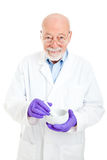 Pharmacist - Experienced and Wise. Wise and experienced pharmacist with his mortar and pestle. Isolated on white background royalty free stock photos