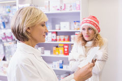 Pharmacist explaining the drug to patient Stock Image