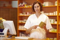 Pharmacist explaining medicine Stock Images