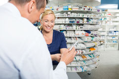 Pharmacist Explaining Product Details To Male Royalty Free Stock Photography